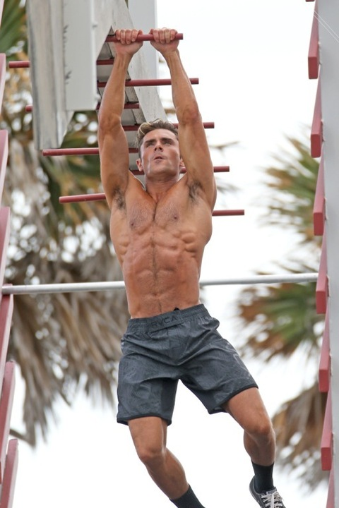 149134, Zac Efron shows off his amazing abs on a Lifeguard obstacle course on the set of 'Baywatch' in Miami. Miami, Florida - Tuesday March 08, 2016. Photograph: Brett Kaffee/Thibault Monnier, © Pacific Coast News. Los Angeles Office: +1 310.822.0419 sales@pacificcoastnews.com FEE MUST BE AGREED PRIOR TO USAGE