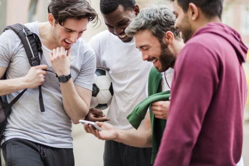 Sports Guys With Smart Phone Having Fun