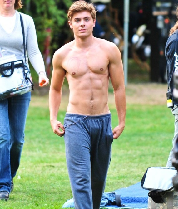 "©NATIONAL PHOTO GROUP Zac Efron films scenes for his upcoming film ""The Death and Life of Charlie St. Cloud."" On set Zac chases geese with trash can tops and eventually comes to take his shirt off. It appears that he drops down to do push ups to stay pumped on set. Job: 082209J2 PREMIUM EXCLUSIVE August 21st, 2009 Burnaby, British Columbia nationalphotogroup.com"