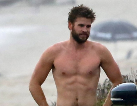 MAN CANDY: Scruffy Liam Hemsworth Reveals Sexy Snail Trail after Surfing — and We're Wet