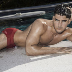MAN CANDY: Green-Eyed Model Charlie Matthews Strips Naked in Poolside Shoot [NSFW-ish]